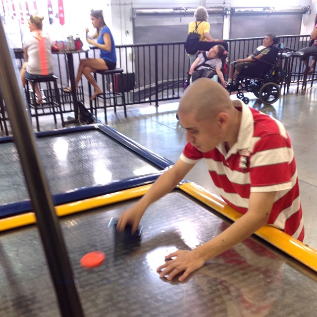 As part of this field trip, students get to have fun playing air hockey and other games.